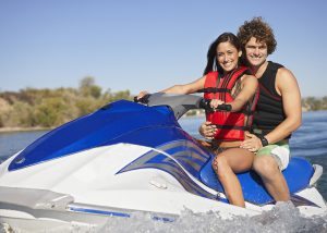 Couple jet skiing